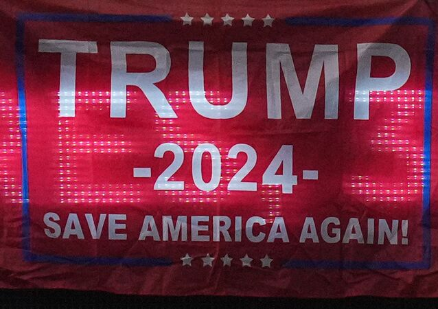 A fan displays a flag in support of former president Donald Trump in the upper deck after the game between the Miami Marlins and the San Diego Padres at loanDepot park