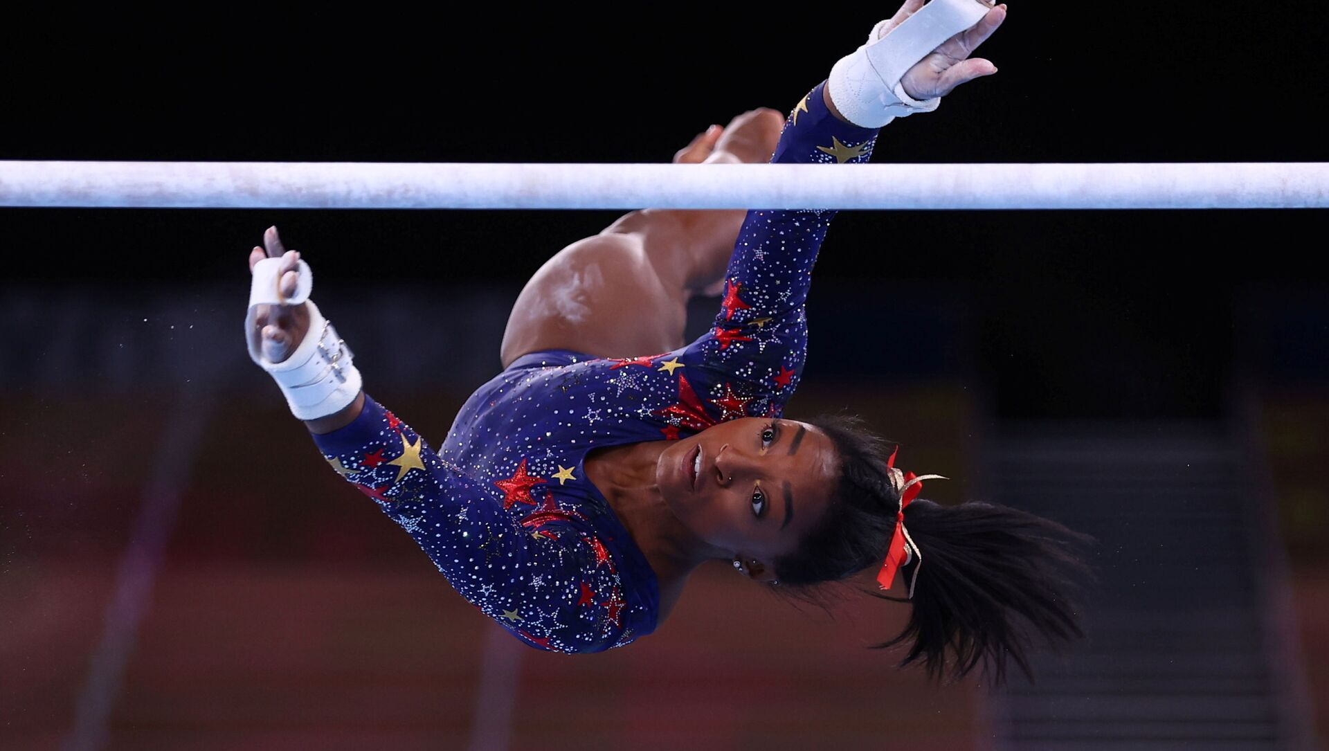 Tokyo 2020 Olympics - Gymnastics - Artistic - Women's Uneven Bars - Qualification - Ariake Gymnastics Centre, Tokyo, Japan - July 25, 2021. Simone Biles of the United States in action during the uneven bars REUTERS/Mike Blake/File photo  SEARCH OLYMPICS DAY 3 FOR TOKYO 2020 OLYMPICS EDITOR'S CHOICE, SEARCH REUTERS OLYMPICS TOPIX FOR ALL EDITOR'S CHOICE PICTURES. - Sputnik International, 1920, 28.07.2021