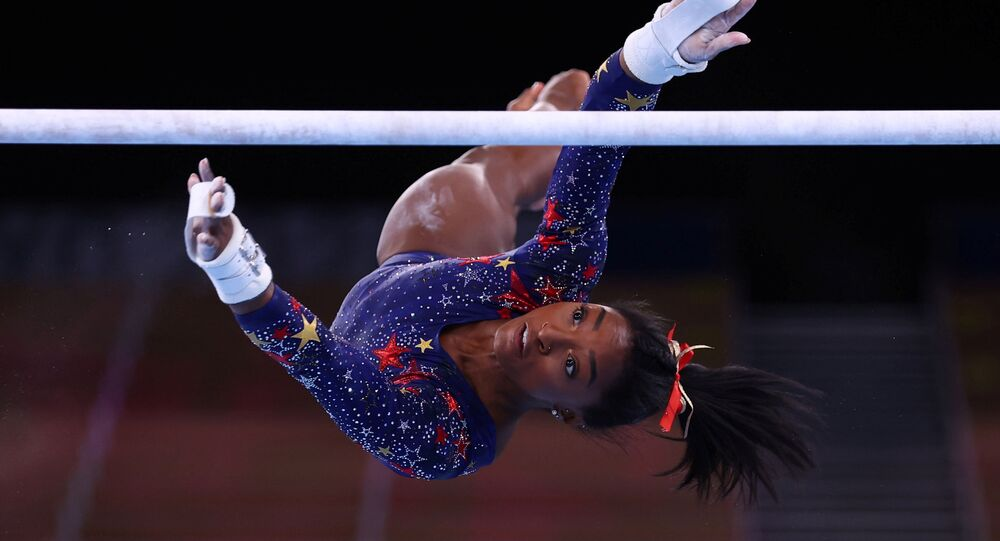 Tokyo 2020 Olympics - Gymnastics - Artistic - Women's Uneven Bars - Qualification - Ariake Gymnastics Centre, Tokyo, Japan - July 25, 2021. Simone Biles of the United States in action during the uneven bars REUTERS/Mike Blake/File photo SEARCH OLYMPICS DAY 3 FOR TOKYO 2020 OLYMPICS EDITOR'S CHOICE, SEARCH REUTERS OLYMPICS TOPIX FOR ALL EDITOR'S CHOICE PICTURES.