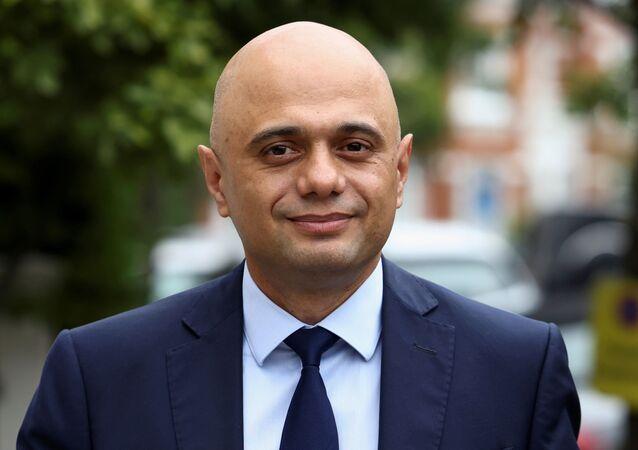 Britain's new Health Secretary Sajid Javid walks outside his home in London, Britain June 27, 2021.