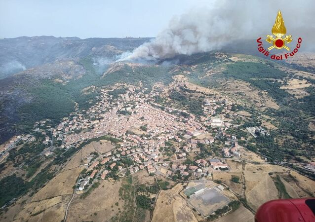 An aerial view from a helicopter shows a large wildfire that broke out near Santu Lussurgiu, Sardinia, Italy July 25, 2021.