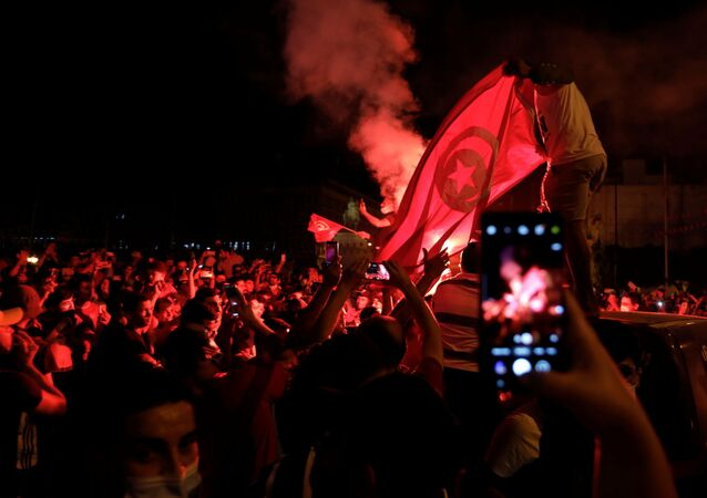 Supporters of Tunisia's President Kais Saied gather on the streets as they celebrate after he dismissed the government and froze parliament, in Tunis, Tunisia July 25, 2021.