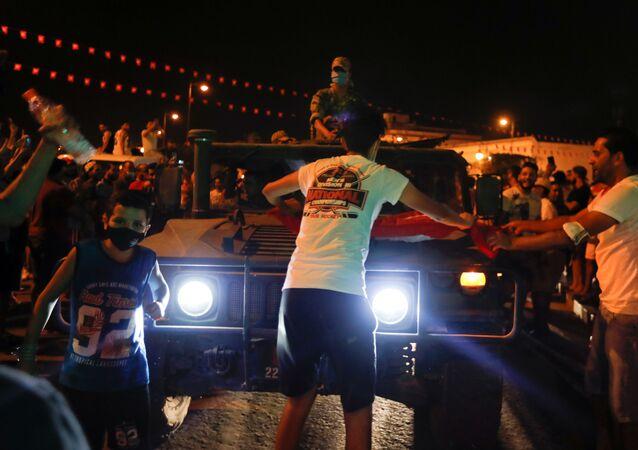 A military vehicle drives on a street as supporters of Tunisia's President Kais Saied gather after he dismissed the government and froze parliament, in Tunis, Tunisia July 25, 2021.