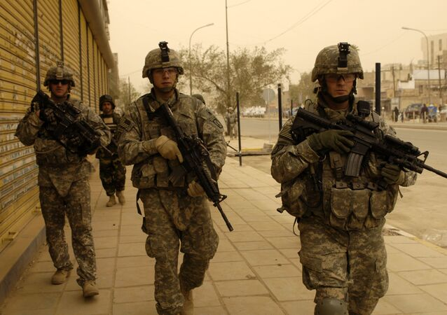 U.S. Army Soldiers assigned to 5th Battalion, 25th Field Artillery Regiment, 4th Brigade Combat Team, 10th Mountain Division, Iraqi National Police from 3rd Battalion, 1st Brigade Combat Team, 1st Division and Iraqi army soldiers conduct a search mission for illegal firearms and improvised explosive device caches in Baghdad, Iraq, March 15, 2008.