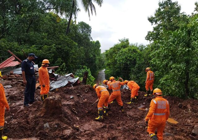 Members of National Disaster Response Force (NDRF) conduct a search and rescue operation after a landslide following heavy rains in Ratnagiri district, Maharashtra state, India, July 25, 2021.