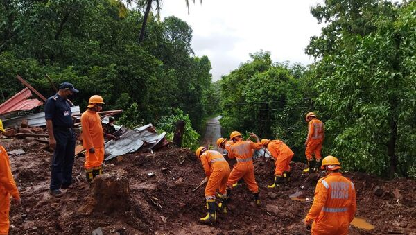 Members of National Disaster Response Force (NDRF) conduct a search and rescue operation after a landslide following heavy rains in Ratnagiri district, Maharashtra state, India, July 25, 2021.  - Sputnik International