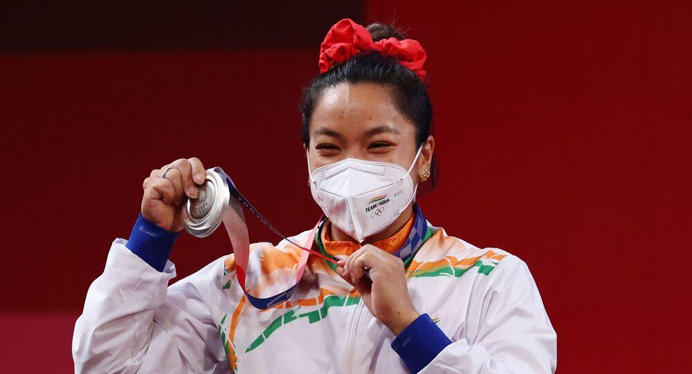 Tokyo 2020 Olympics - Weightlifting - Women's 49kg - Medal Ceremony - Tokyo International Forum, Tokyo, Japan - July 24, 2021. Silver medalist Mirabai Chanu Saikhom of India reacts.