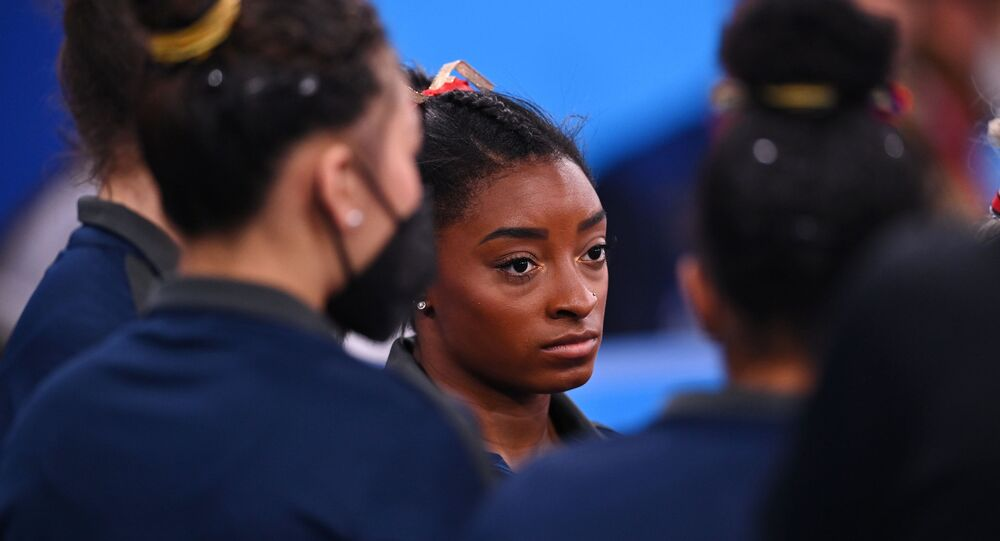 Tokyo 2020 Olympics - Gymnastics - Artistic - Women's Individual All-Around - Qualification - Ariake Gymnastics Centre, Tokyo, Japan - July 25, 2021. Simone Biles of the United States looks on during competition.