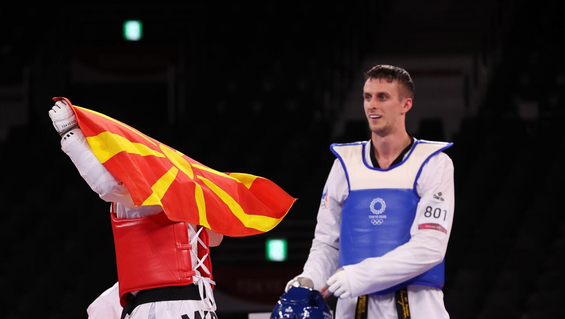 Vladislav Larin of the Russian Olympic Committee and Dejan Georgievski of North Macedonia react after competing, Taekwondo, Men's Heavyweight +80kg. July 27, 2021 - Sputnik International, 1920, 27.07.2021