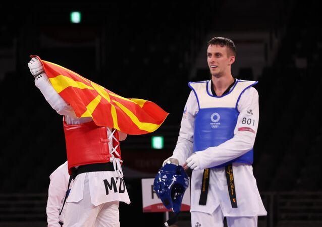 Vladislav Larin of the Russian Olympic Committee and Dejan Georgievski of North Macedonia react after competing, Taekwondo, Men's Heavyweight +80kg. July 27, 2021