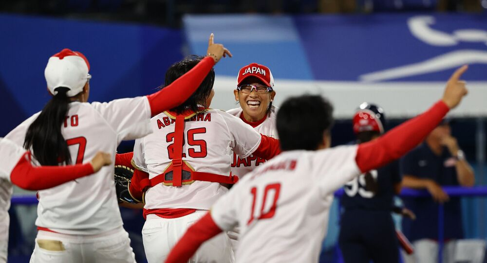 Yukiko Ueno of Japan and team mates celebrate winning the game. Tokyo 2020 Olympics - Softball - Women - Finals - Japan v United States. 27 July 2021