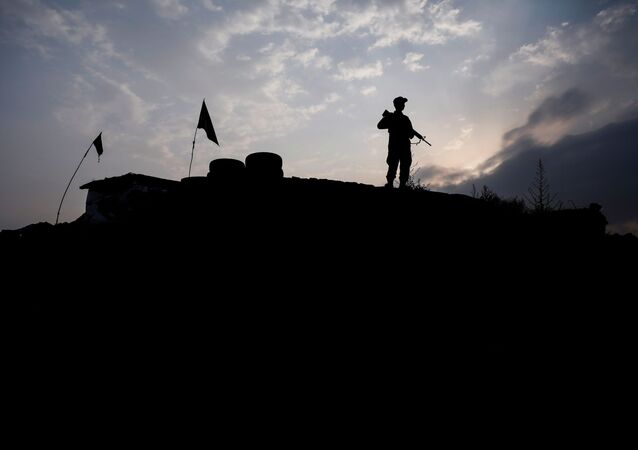 An Afghan police officer keeps watch at the check post on the outskirts of Kabul, Afghanistan July 13, 2021.