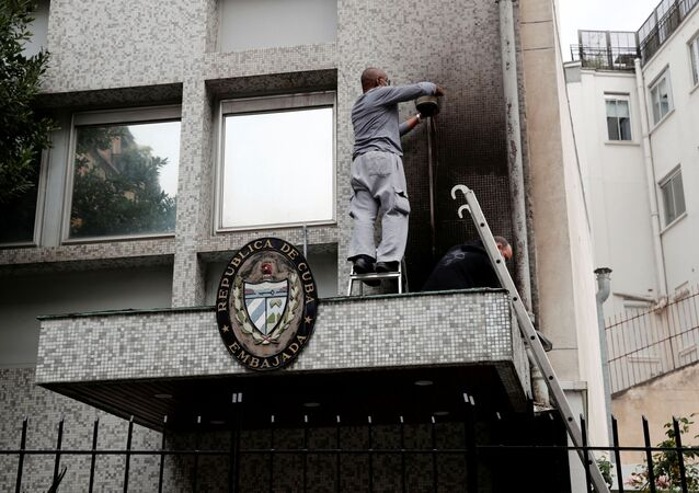 Experts inspect the damage at the Cuban embassy following an overnight petrol bomb attack on its building, in Paris, France July 27, 2021.