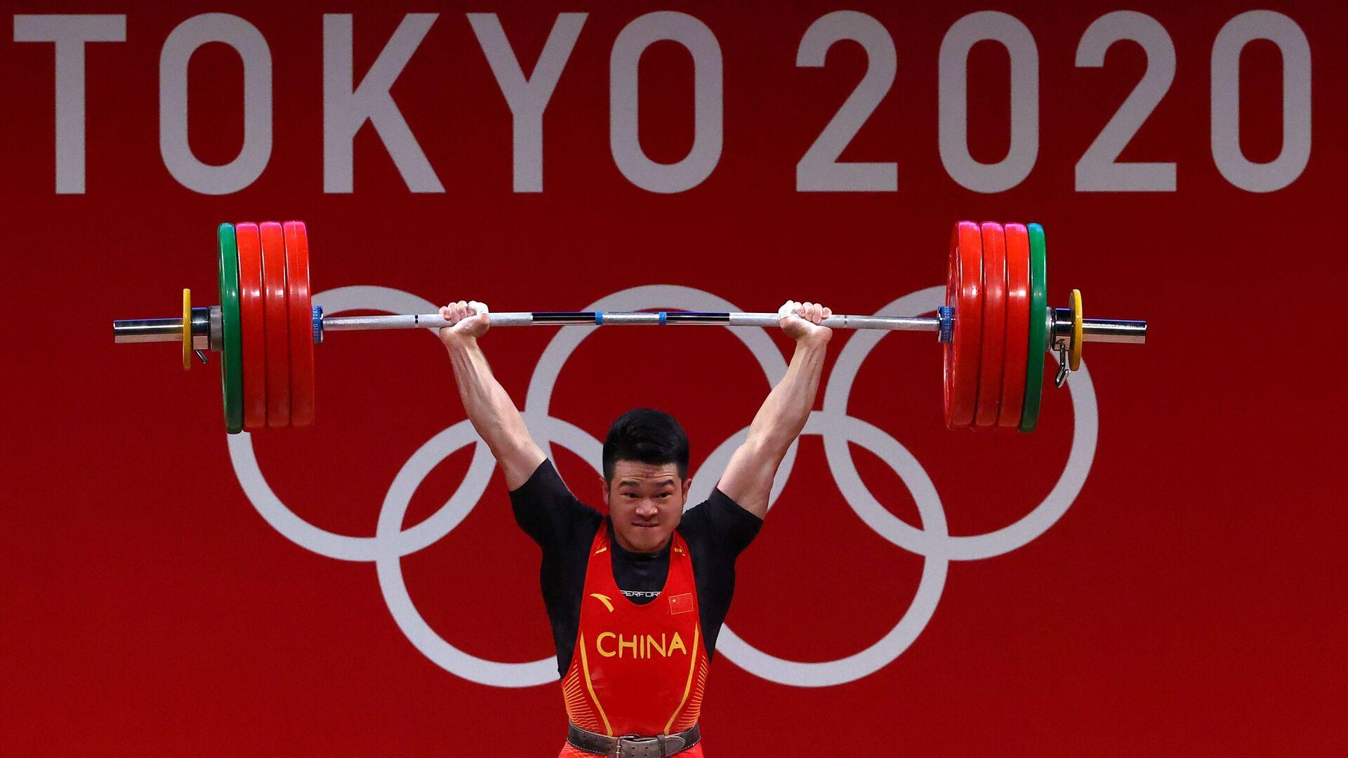 Tokyo 2020 Olympics - Weightlifting - Men's 73kg - Group A - Tokyo International Forum, Tokyo, Japan - July 28, 2021. Shi Zhiyong of China in action - Sputnik International, 1920, 07.09.2021
