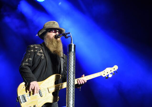Member of the US band ZZ Top, Dusty Hill performs on the stage during the 28th Eurockeennes rock music festival on July 3, 2016 in Belfort, eastern France.
