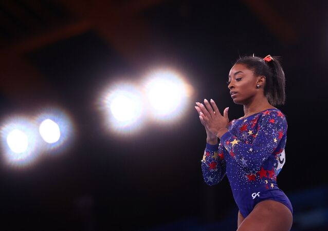 Tokyo 2020 Olympics - Gymnastics - Artistic - Women's Beam - Qualification - Ariake Gymnastics Centre, Tokyo, Japan - July 25, 2021. Simone Biles of the United States in action on the beam.