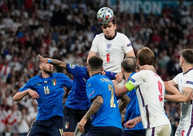 Harry Maguire heads the ball for England against Italy in Euro 2020 final