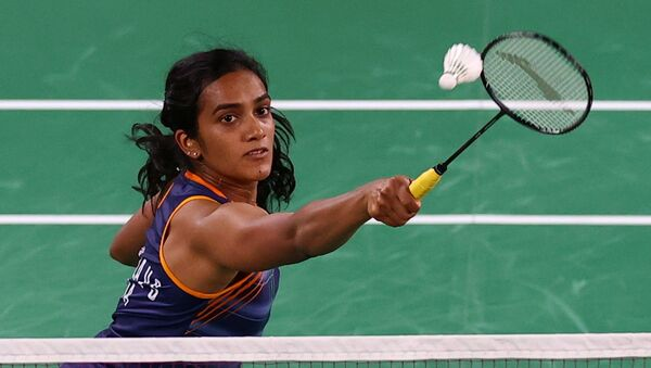 P.V. Sindhu of India in action during the match against Ksenia Polikarpova of Israel - Sputnik International