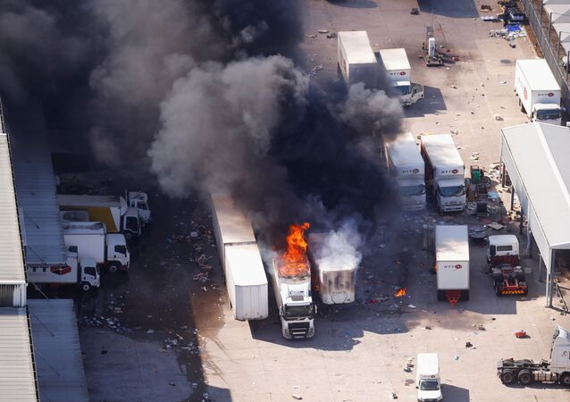 A general view of burning trucks after violence erupted following the jailing of former South African President Jacob Zuma, in Durban, South Africa, July 14, 2021