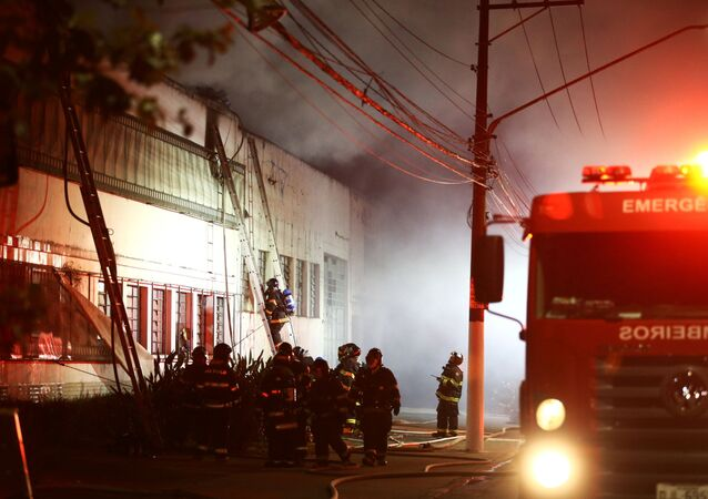 Firefighters work to put out fire at the Cinemateca Brasileira, an institution responsible for preserving audiovisual production, in Sao Paulo, Brazil July 29, 2021