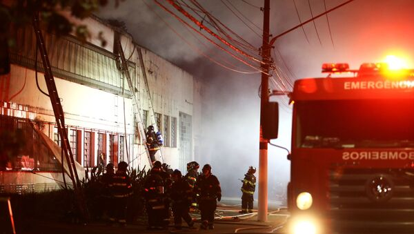 Firefighters work to put out fire at the Cinemateca Brasileira, an institution responsible for preserving audiovisual production, in Sao Paulo, Brazil July 29, 2021 - Sputnik International