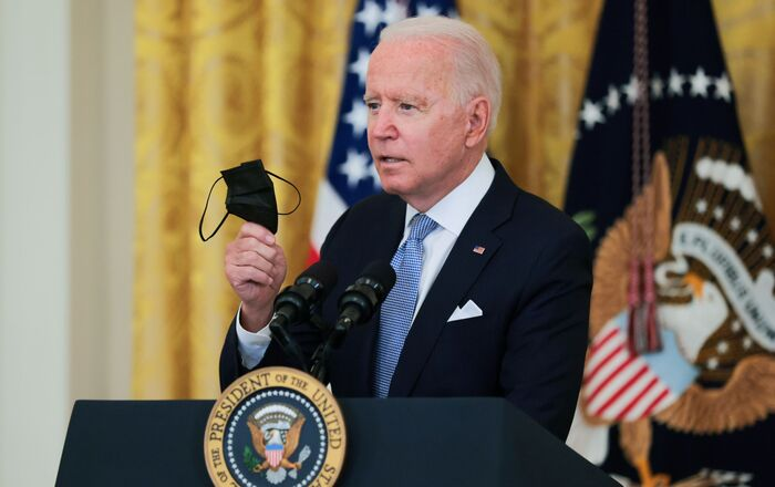 U.S. President Joe Biden holds his mask as he speaks about the pace of coronavirus disease (COVID-19) vaccinations in the United States during remarks in the East Room of the White House in Washington, U.S., July 29, 2021