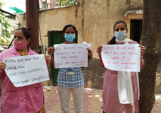 ASHA workers call for fixed working hours and wages as they keep fighting COVID across India.