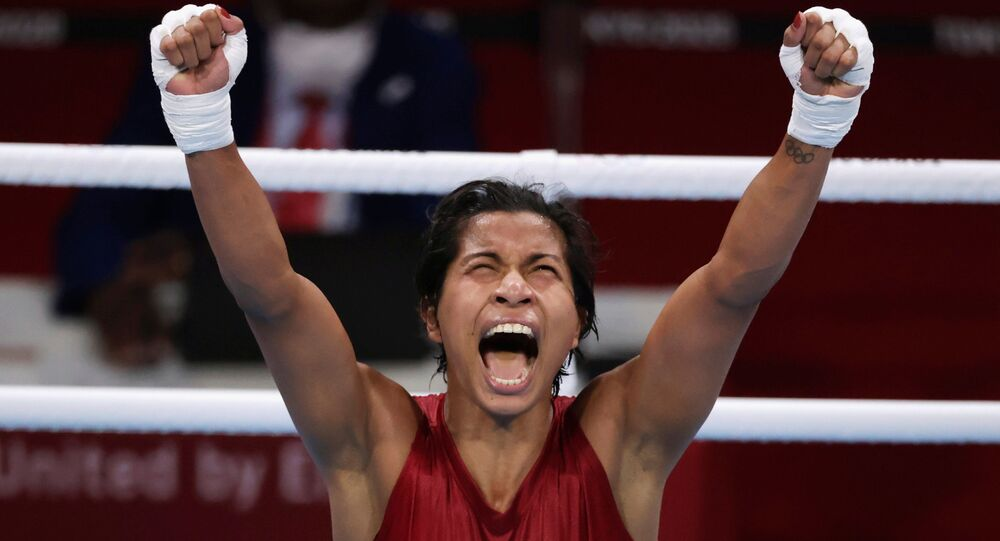 Tokyo 2020 Olympics - Boxing - Women's Welterweight - Quarterfinal - Kokugikan Arena - Tokyo, Japan - July 30, 2021. Lovlina Borgohain of India celebrates after the fight against Chen Nien-Chin of Taiwan.