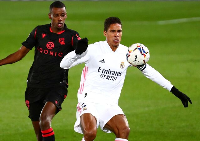 Real Madrid's Raphael Varane (right) in action against Real Sociedad.