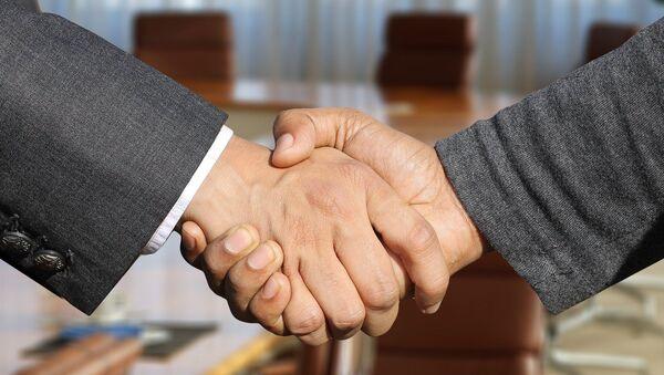 handshake - Sputnik International