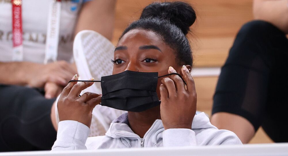 Tokyo 2020 Olympics - Gymnastics - Artistic - Women's Individual All-Around - Final - Ariake Gymnastics Centre, Tokyo, Japan - July 29, 2021. Simone Biles of the United States puts on a protective face mask.