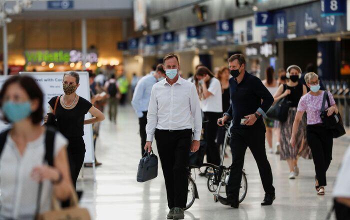Commuters walk through Waterloo station, amid the coronavirus disease (COVID-19) pandemic, London, Britain, July 19, 2021