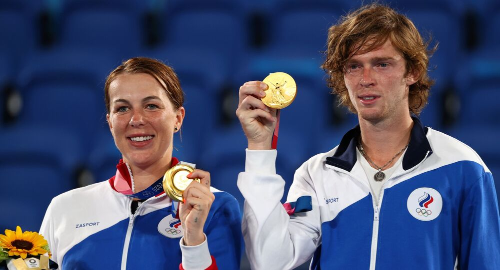 old medallists Anastasia Pavlyuchenkova and Andrey Rublev of the Russian Olympic Committee on the podium REUTERS/Stoyan Nenov