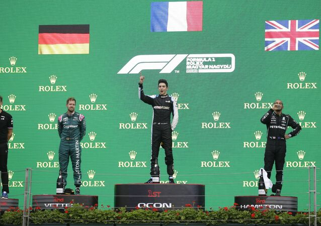 Formula One F1 - Hungarian Grand Prix - Hungaroring, Budapest, Hungary - August 1, 2021 Second placed Sebastian Vettel of Aston Martin, first placed Esteban Ocon of Alpine and third placed Lewis Hamilton of Mercedes on the podium after the race
