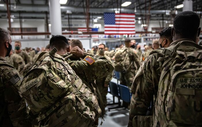 FORT DRUM, NEW YORK - DECEMBER 08: U.S. Army soldiers from the 10th Mountain Division arrive from a 9-month deployment in Afghanistan on December 08, 2020 in Fort Drum, New York.