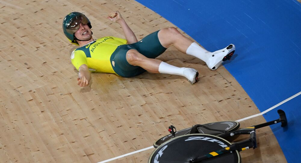 Australia's Alexander Porter reacts after crashing during the men's track cycling team pursuit qualifying event during the Tokyo 2020 Olympic Games at Izu Velodrome in Izu, Japan, on 2 August 2021.