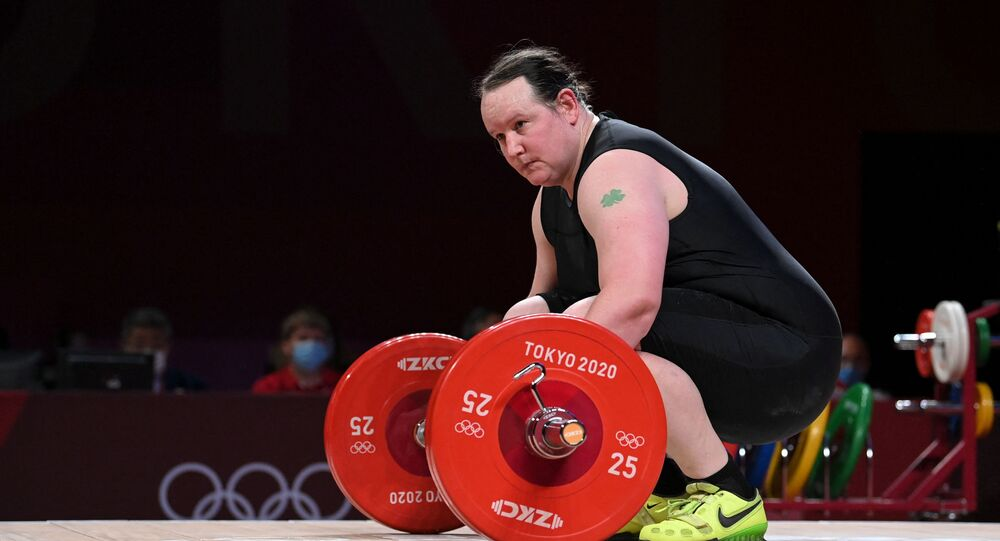 New Zealand's Laurel Hubbard reacts in the women's +87kg weightlifting competition during the Tokyo 2020 Olympic Games at the Tokyo International Forum in Tokyo on August 2, 2021.