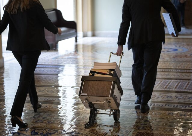 Documents, including text of the bipartisan infrastructure legislation, is wheeled toward the office of Senate Majority Leader Chuck Schumer (D-NY) at the U.S. Capitol on August 2, 2021 in Washington, DC.