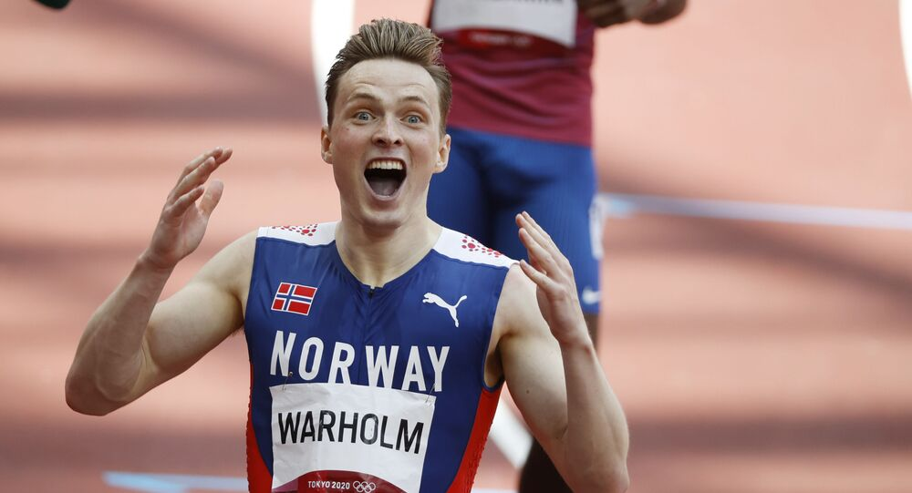 Karsten Warholm of Norway celebrates after winning gold and setting a new world record