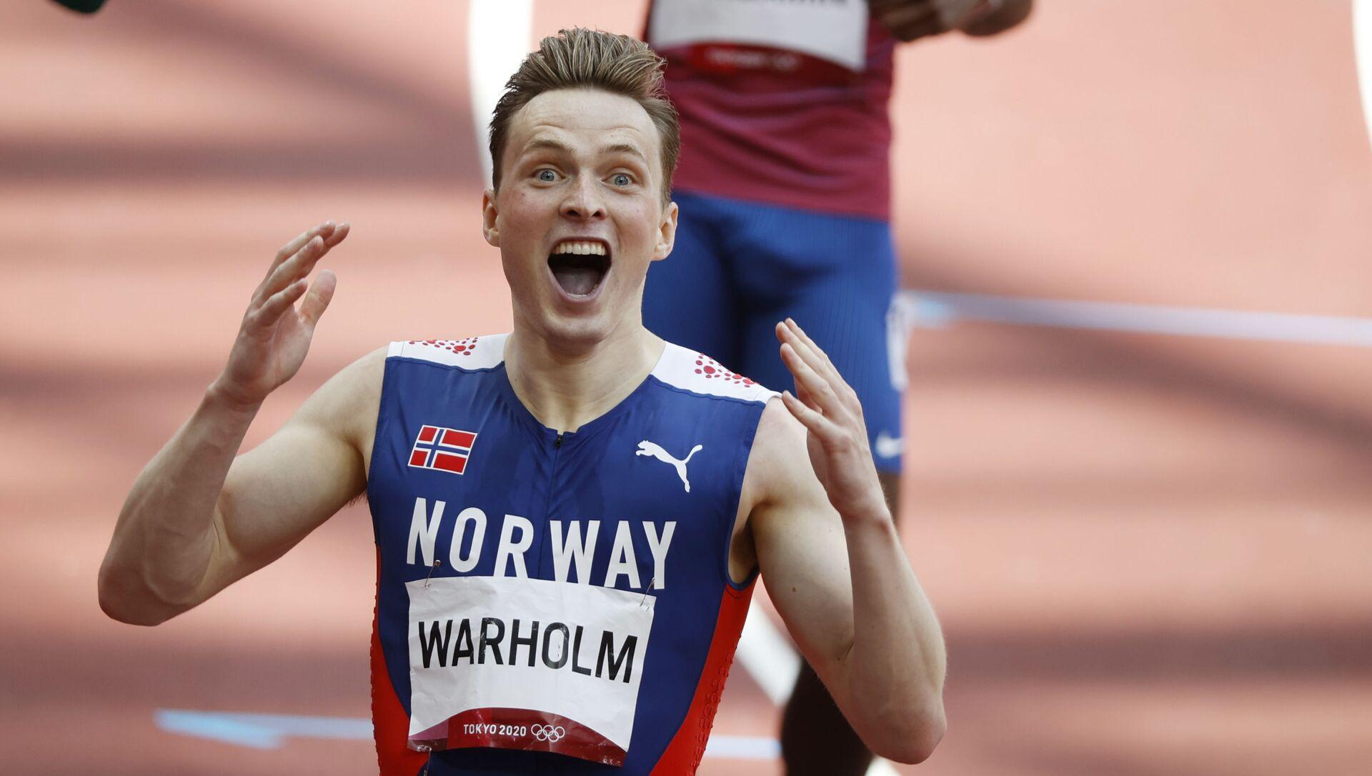 Karsten Warholm of Norway celebrates after winning gold and setting a new world record - Sputnik International, 1920, 03.08.2021