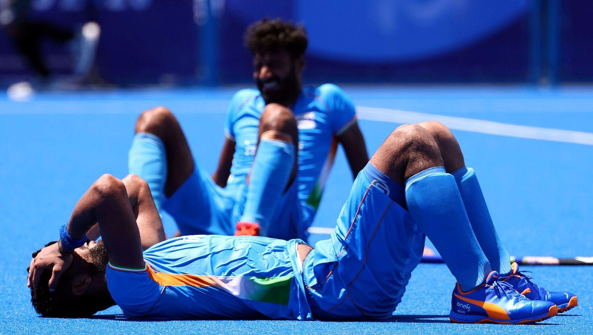 Tokyo 2020 Olympics - Hockey - Men - Semifinal - India v Belgium - Oi Hockey Stadium, Tokyo, Japan - August 3, 2021. Rupinder Pal Singh of India reacts after losing their match. - Sputnik International, 1920, 03.08.2021