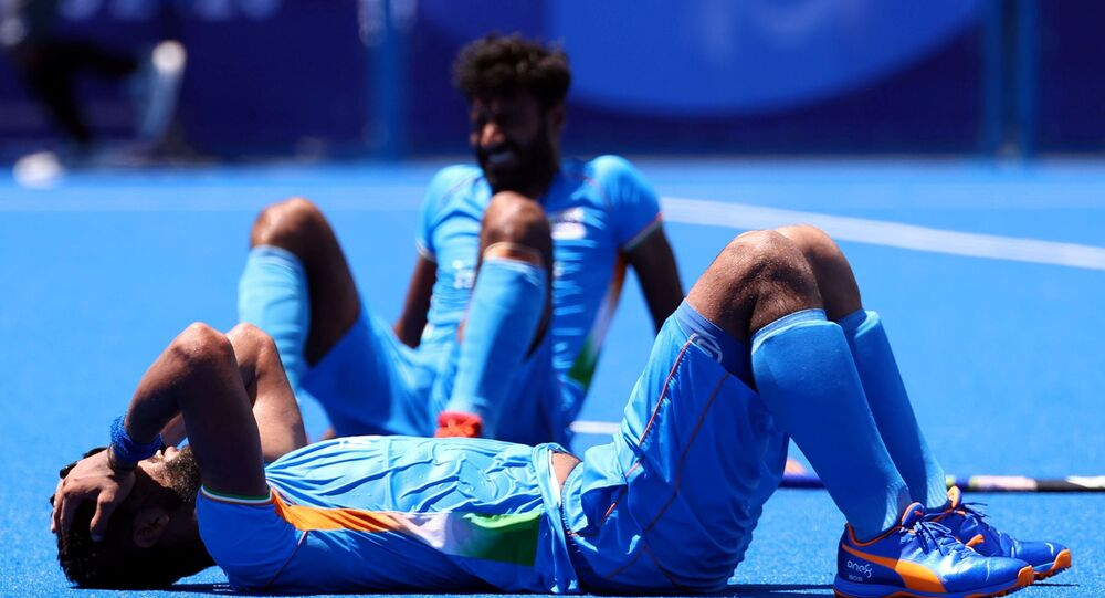 Tokyo 2020 Olympics - Hockey - Men - Semifinal - India v Belgium - Oi Hockey Stadium, Tokyo, Japan - August 3, 2021. Rupinder Pal Singh of India reacts after losing their match.
