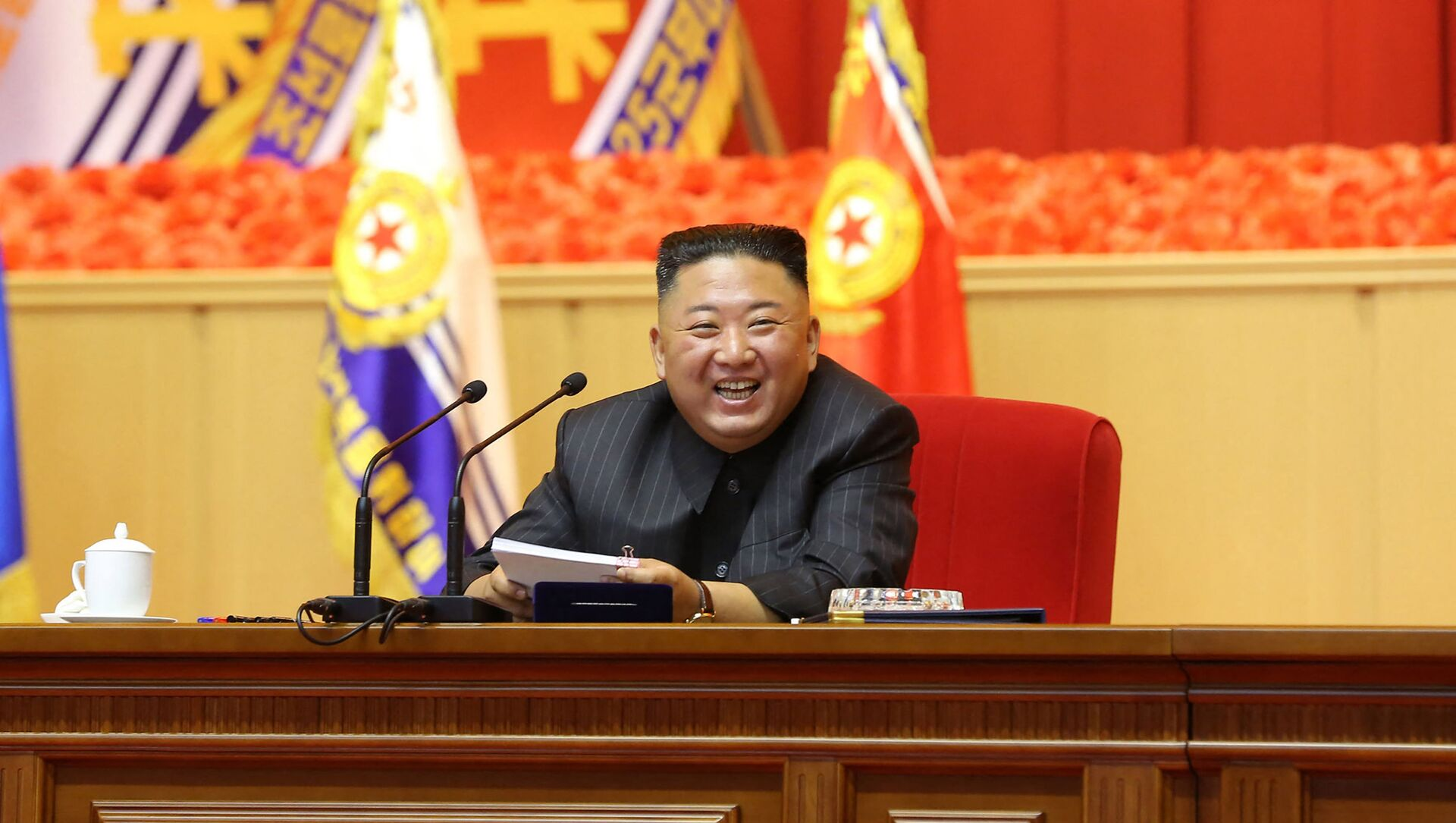 This undated picture released from North Korea's official Korean Central News Agency (KCNA) on July 30, 2021 shows North Korean leader Kim Jong Un taking part in the First Workshop of KPA Commanders and Political Officers, at April 25 House of Culture in Pyongyang. - Sputnik International, 1920, 03.08.2021