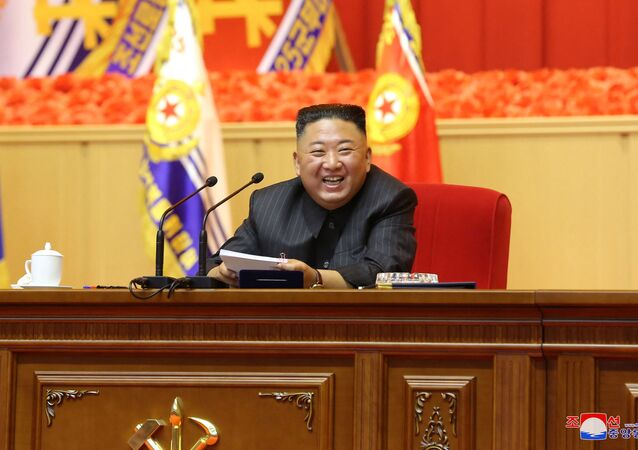 This undated picture released from North Korea's official Korean Central News Agency (KCNA) on July 30, 2021 shows North Korean leader Kim Jong Un taking part in the First Workshop of KPA Commanders and Political Officers, at April 25 House of Culture in Pyongyang.