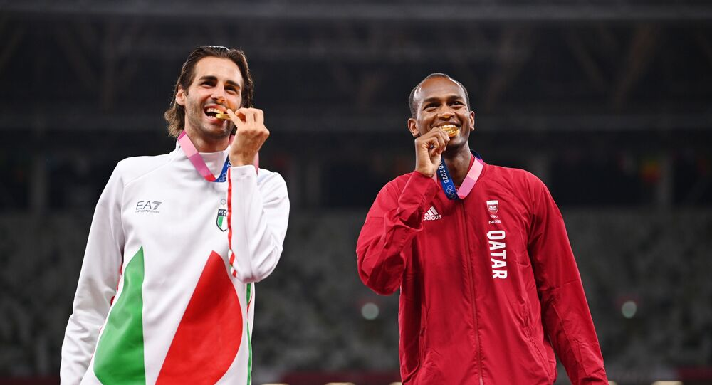 Tokyo 2020 Olympics - Athletics - Men's High Jump - Medal Ceremony - Olympic Stadium, Tokyo, Japan – August 2, 2021. Gold medallists, Gianmarco Tamberi of Italy and Mutaz Essa Barshim of Qatar pose on the podium