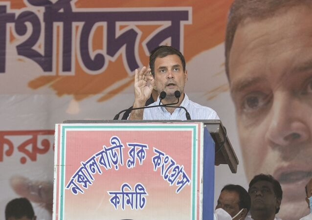 India's Congress party leader Rahul Gandhi gestures as he addresses a rally during an election campaign at Shibmandir on the outskirts of Siliguri on April 14, 2021.