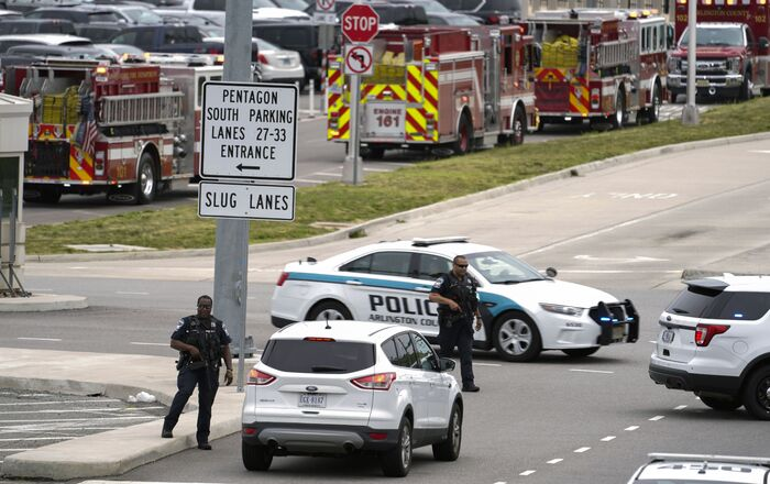 Emergency vehicles are seen outside the Pentagon Metro area Tuesday, Aug. 3, 2021, at the Pentagon in Washington. The Pentagon is on lockdown after multiple gunshots were fired near a platform by the facility's Metro station.