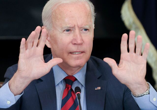 U.S. President Joe Biden quiets reporters as he concludes his remarks to a meeting with Latino community leaders at the White House in Washington, U.S. August 3, 2021