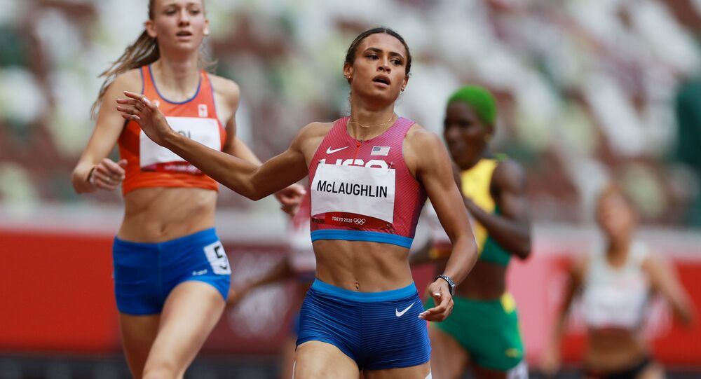 Sydney McLaughlin of the United States crosses the line to win gold