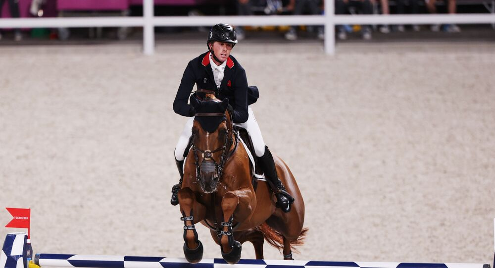Tokyo 2020 Olympics - Equestrian - Jumping - Individual - Final - Equestrian Park - Tokyo, Japan - August 4, 2021. Ben Maher of Britain on his horse Explosion W competes